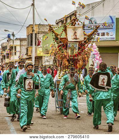 Latacunga, Ecuador - September 22, 2018 - The Strongest Men Of Each Neighborhood Carries A Pig And A