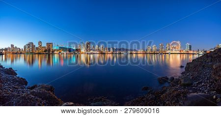 skyline at night of vancouver canada