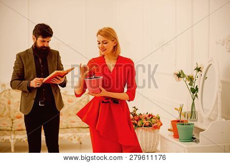 Family Concept. Family Of Woman And Man At Home. Sensual Woman Hold Green Plant While Bearded Man Re