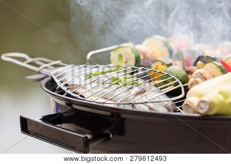 Close-up of food on barbecue grill at park