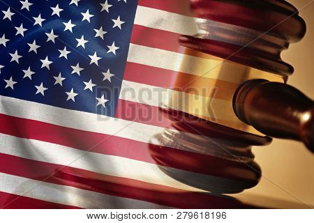 Wooden Judges Gavel Overlaid With The Flag Of The United States In A Concept Of Legalities, Judgemen