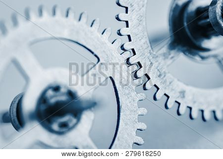 Two Meshed Toothed Steel Gear Wheels Or Cogs With Selective Focus To The Interlocked Teeth And Copy