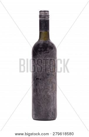 Old Bottle Of Wine, Covered In Dust