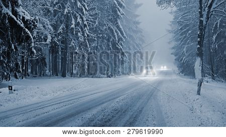 Snowy Winter Road With Car. Dangerous Car Driving In The Mountains In The Winter. Concept For Transp