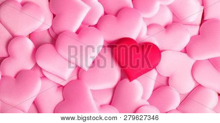 Valentine's Day hearts Background. Holiday Abstract Valentine Background with pink and red satin Hearts. Hearts top view backdrop. Love concept, wedding. Flatlay