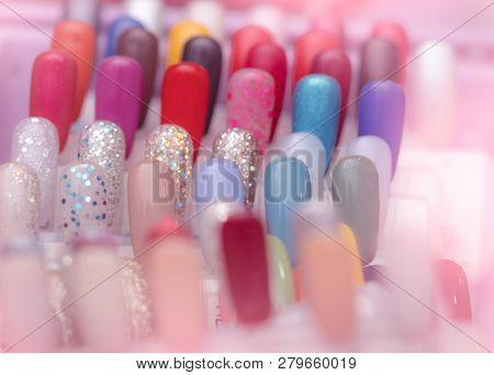 Colorful Artificial Nails In Nail Salon Shop. Set Of False Nails For Customer To Choose Color For Ma