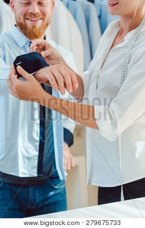 Man in fitting of a bespoke shirt in fashion studio of tailor