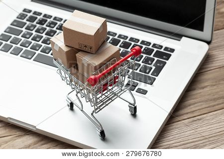 Delivery Of The Order From The Online Store. Online Shopping. Boxes With Goods In The Shopping Baske