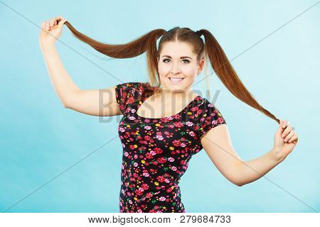Education, Teenage Adolescence, Happiness Concept. Happy Teenager Student Girl With Ponytails Having
