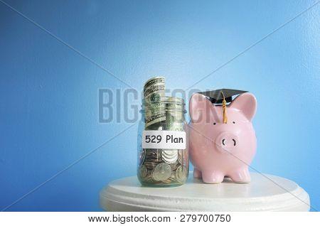 Piggy Bank With Graduation Cap And 529 Plan Coin Jar -- College Savings Plan Concept