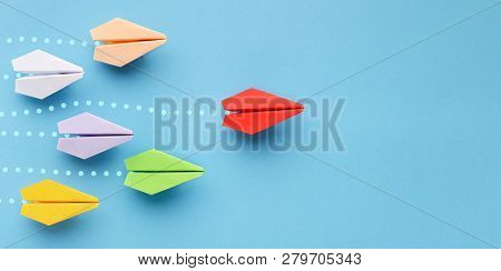Opinion Leadership Concept. Red Paper Plane Leading Another Colorful Ones, Influencing The Crowd, Bl