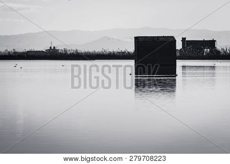 Reflection Of The Booths In The Water Of The Rice Fields. Lagoons In The Natural Park Of Albufera, V