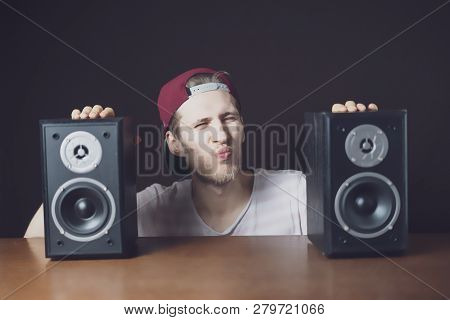 Young Man Audiophile Listen To Loud Music From Speakers