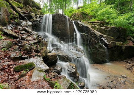Beautiful Waterfall Among The Huge Rocks In Forest. Beautiful Nature Summer Scenery. Refreshing Envi