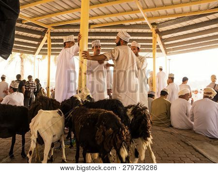 Nizwa, Oman - November 2, 2018: Men Negotiate The Price For The Sale Of Animals At The Friday Animal