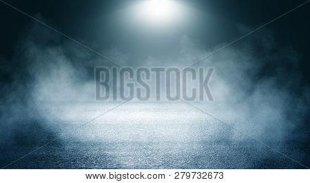Black Background Of Empty Street, Room, Blue Searchlight Illuminates Asphalt, Smoke