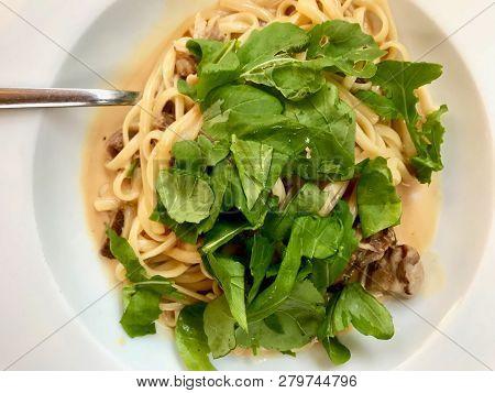 Linguini Pasta With Lamb Meat, Cream Sauce And Arugula, Rocket Or Rucola Leaves.