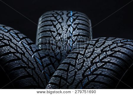 Winter Tyres On Black Background With Contrasty Lighting