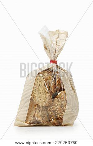 Sliced Multi Grain Bread In Paper Bag Isolated