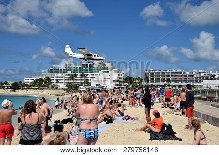 St Martin, Dutch Antelles - December 25, 2018: Airplanes Land Low Over Maho Beach, St Martin. The De