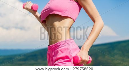 Fitness Woman In Training. Sporty Woman Does The Exercises With Dumbbells. Sports Fitness Sexy Girl,