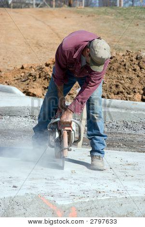 Man Cutting Concrete