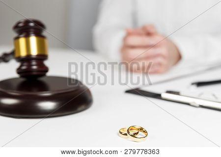 Judge Gavel Deciding On Marriage Divorce. Hands Of Judge, Signing Decree Of Divorce, Dissolution, Ca