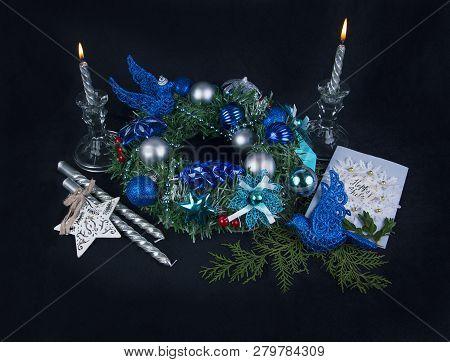 Yuletide Celebration Staff. Candles And Presents On Black Background