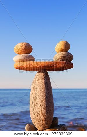Symbolic Scale Of The Stones On Sea Background Closeup. Concept Of Harmony And Balance. Work-life, E
