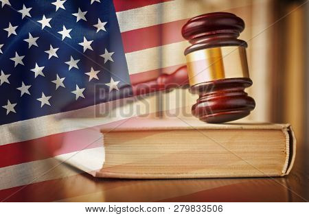 Judges Gavel With Law Book In Court And Us Flag In A Concept Of Judgement, Prosecution, The Law And