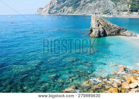 The Coast Of Monterosso. View Of Monterosso Al Mare Beach, In Summer Season, A Coastal Village And R