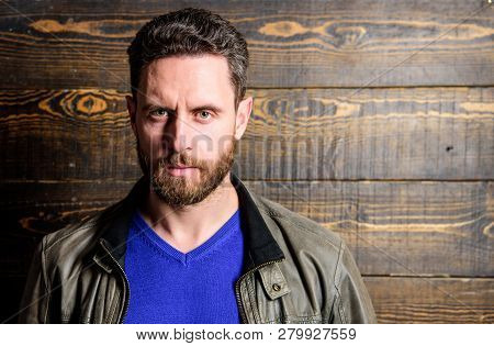 Hipster With Mustache And Beard. Mature Serious Confident Man With Beard Wooden Background. Confiden