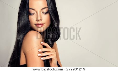 Beautiful Model Girl With Shiny Black And Straight Long  Hair . Keratin  Straightening . Treatment,