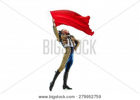 Torero In Blue And Gold Suit Or Typical Spanish Bullfighter Isolated Over White Studio Background. T