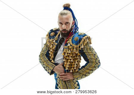 Torero in blue and gold suit or typical spanish bullfighter isolated over white studio background. The taming, achieving the goal, mortification, conquest, boss, leadership, battle, win, winner concept poster