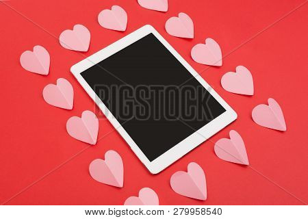 Touchpad On Red Background With Paper Cut Hearts. Tablet Computer With Blank Screen For Your Copy