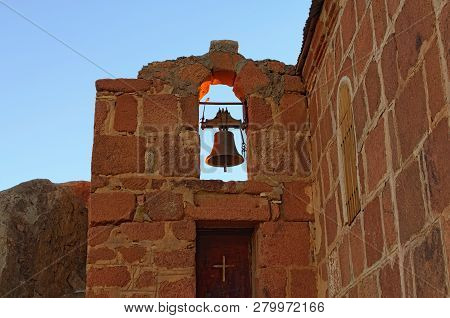 The old bell of the Church of the Holy Trinity on the top of Mount Sinai (Mount Horeb, Gabal Musa, Moses Mount). Sacred christian building in Egypt. Sinai Peninsula of Egypt. poster