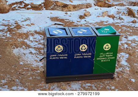 Three large metal containers for different types of garbage. At the top of Mount Sinai (Mount Horeb, Gabal Musa, Moses Mount). Sinai Peninsula of Egypt. Pilgrimage place and touristic destination. poster