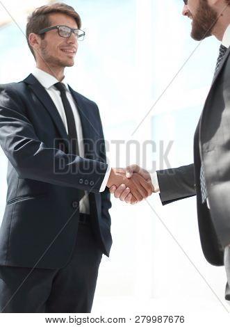 close up.handshake business partners.