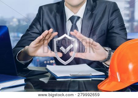 A Closeup Of An Engineer Or An Owner Of A Building Company Sitting At The Table And Holding His Hand