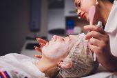 Beautician womans face, closeup. Biorevitalization procedure. before the procedure, painkillers, freezing. poster