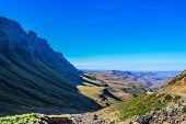 Greenery in Sani pass under blue sky near Lesotho South Africa border near KZN and Midlands meander poster