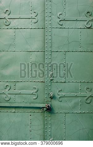 Close-up Of The Castle-closed Green Gate With Patterns, Squares And Rivets.