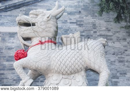 A Mythical Creature Called A Kylin With A Red Ribbon Around Its Neck At Zhanshan Temple In The City