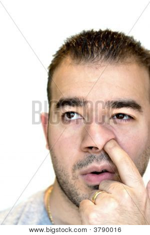 A shot of a man digging for gold - the nose picker. poster