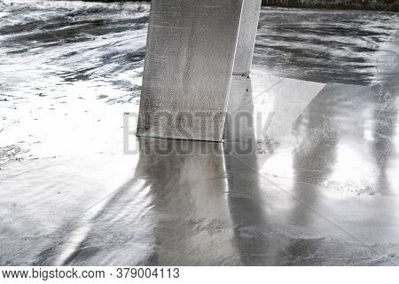 Galvanized Parts. Galvanized Industrial Parts On A Construction Site. Galvanizing Factory Process. G