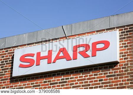 Ega, Denmark - May 11, 2019: Sharp Logo On A Facade. Sharp Is A Japanese Multinational Corporation T