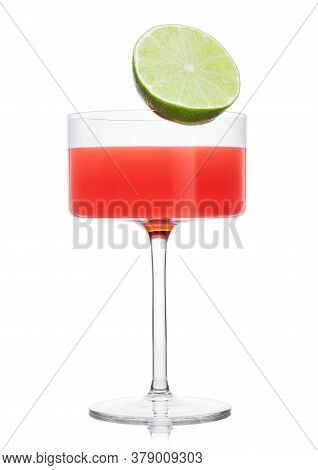 Cosmopolitan Cocktail In Modern Crystal Glass With Lime Half On White Background.