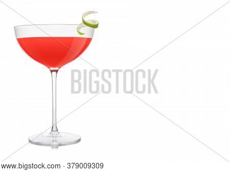 Cosmopolitan Cocktail In Luxury Crystal Glass With Lime Peel On White Background. Space For Text