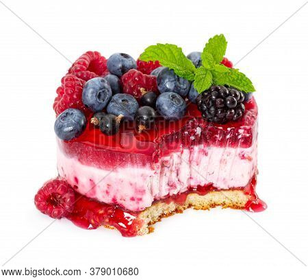 Cheesecake With Fresh Berries, Mint, Jelly And Raspberries Jam Isolated On White Background.
